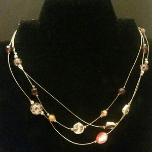 Gold tone wire with leopard baubles